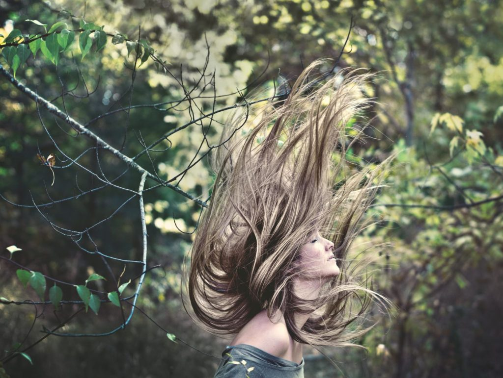Girl in Forest Photo caption